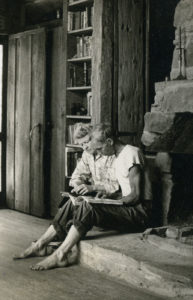 Anna and Harlan Hubbard in their cabin reading